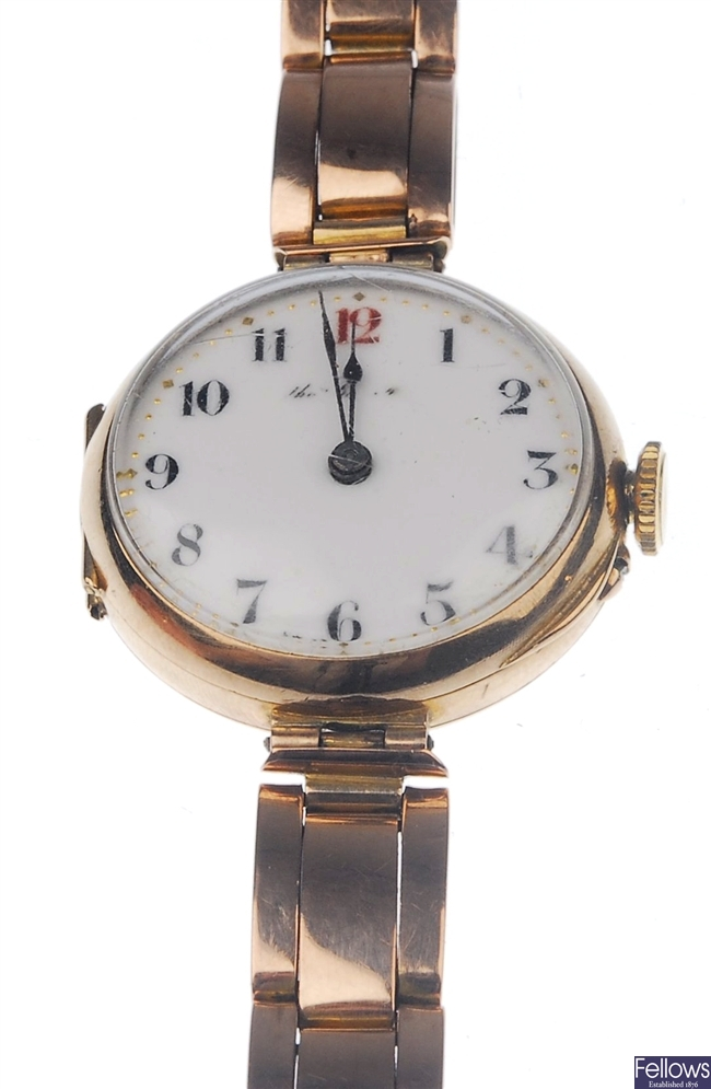 A 9ct gold circular watch with white dial, black