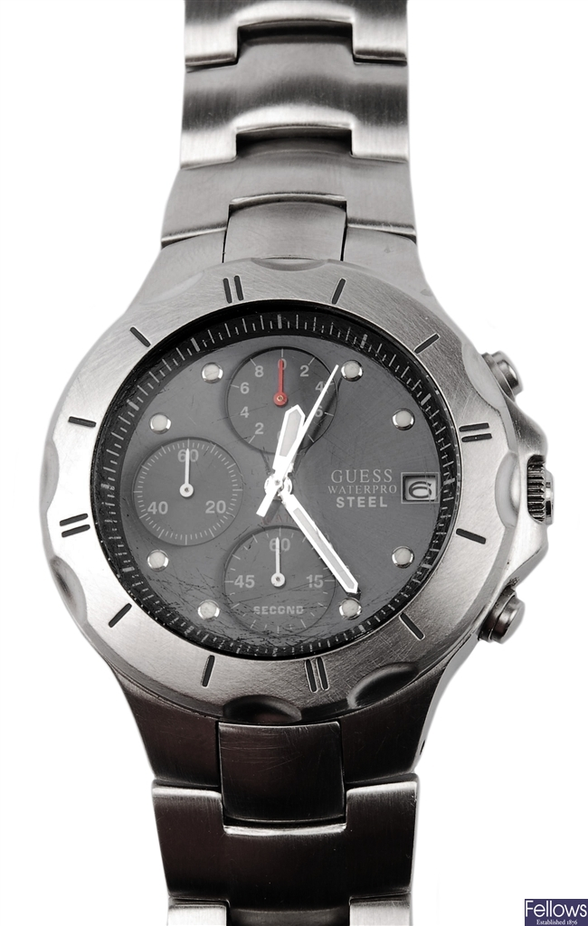 GUESS - a gentleman's steel watch with blue dial,