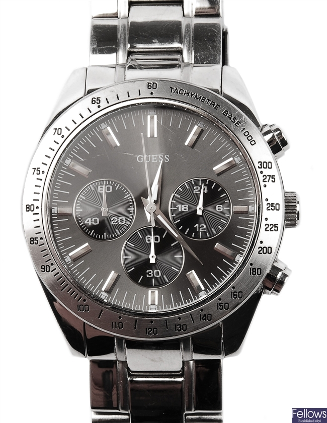 GUESS - a gentleman's stainless steel watch with