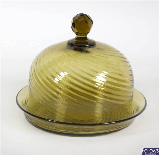 An early 20th century green glass cheese dish
