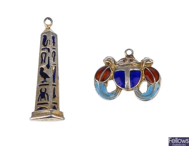 Two tiny silver gilt charms enamelled in