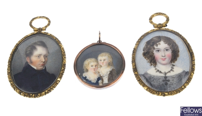 Two Victorian oval base metal mounted portrait