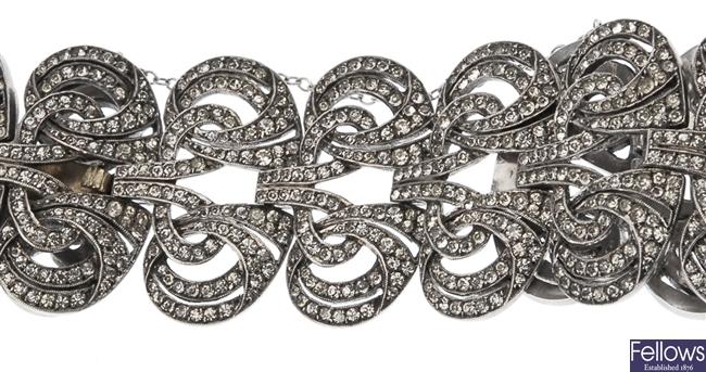 A white metal colourless paste bracelet of