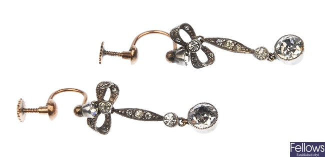 A pair of dropper earrings set with colourless