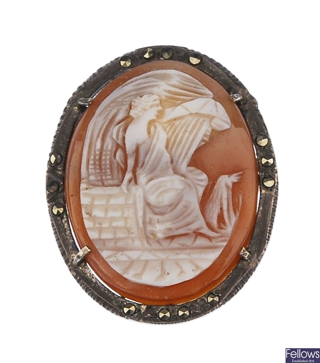 A number of shell cameo brooches, to include a an