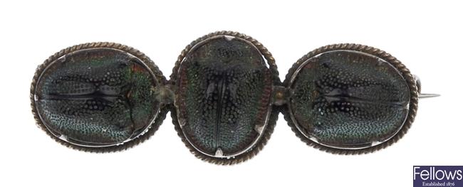 A scarab beetle set bar brooch, with three claw