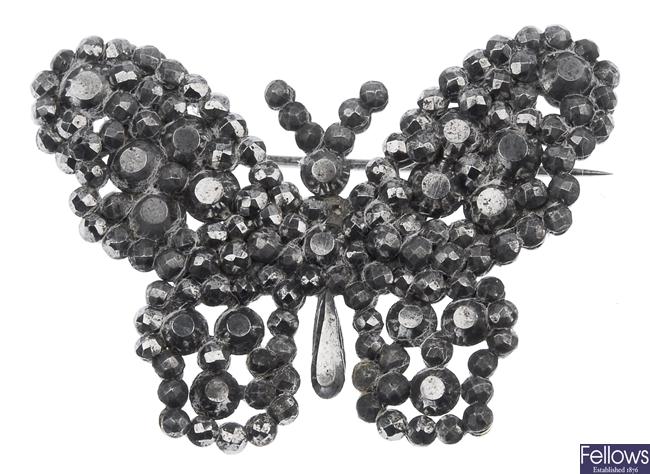 A cut steel brooch in the form of a butterfly,