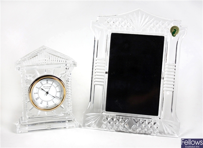 A Waterford crystal clock case, a similar smaller example, two cut glass bowls and other items
