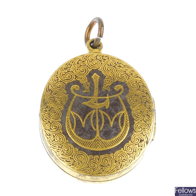 An oval hinged locket.