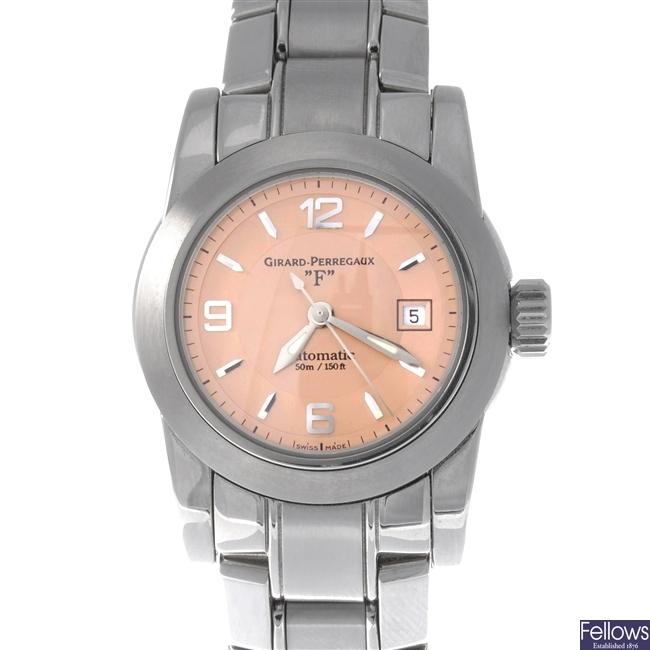 A Girard Perregaux bracelet watch.
