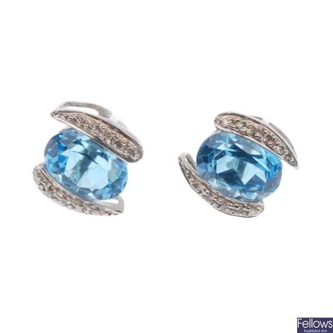 18ct white gold blue topaz and diamond stud earrings.