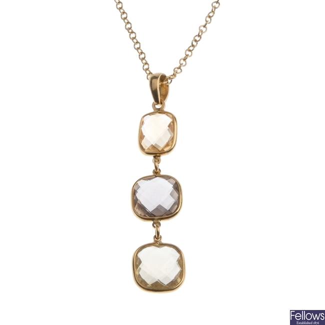 18ct gold citrine and smokey quartz pendant.