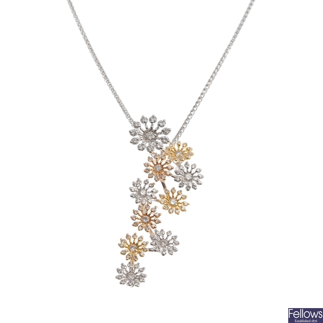 A diamond set floral design pendant.
