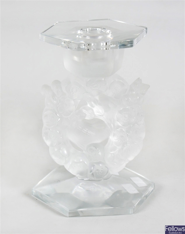 A Lalique clear and frosted glass candlestick.
