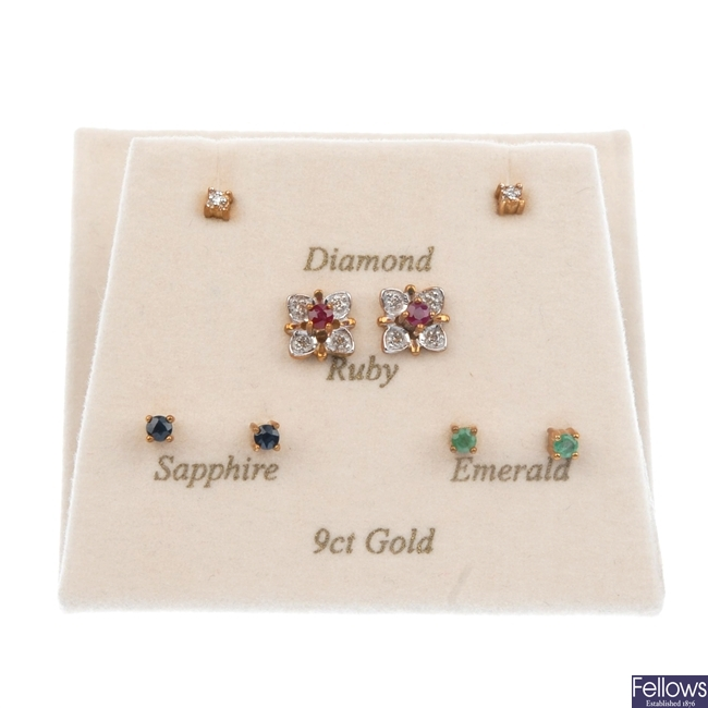A pair of diamond cluster earrings with interchangeable centres.