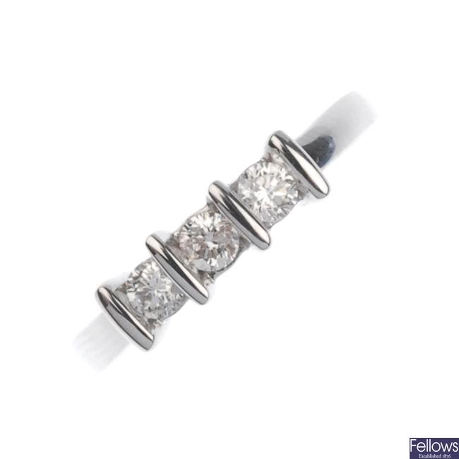 18ct white gold three stone diamond ring.
