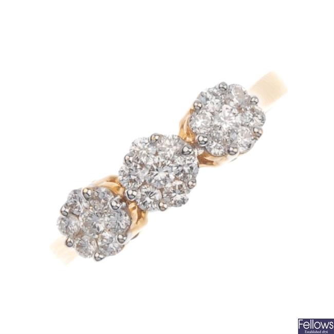 18ct gold triple diamond cluster ring.