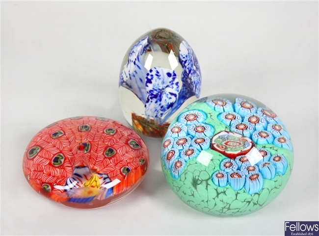 Two Medina coloured glass paperweights and three other paperweights