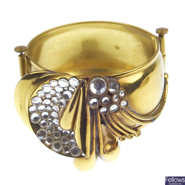 A large hinged bangle with applied decoration and paste stones and matching necklet.
