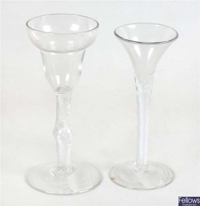 A wine glass with air twist knopped stem and a similar wine glass