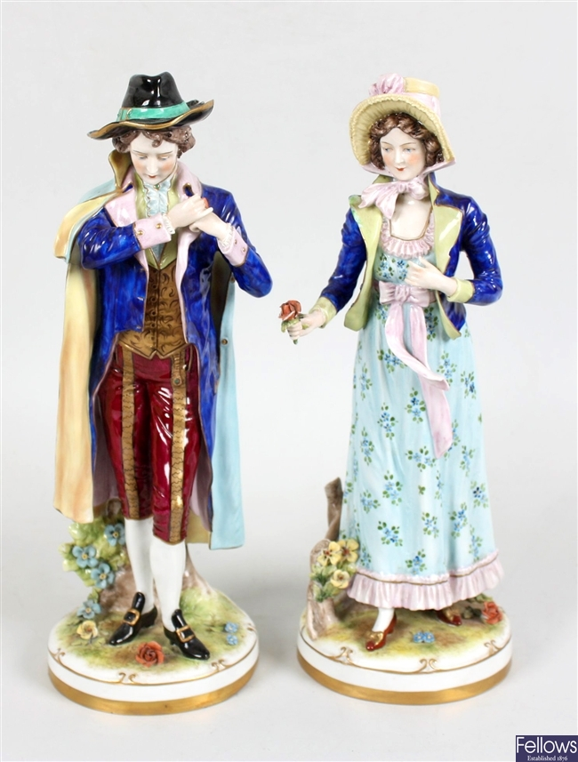A pair of Sitzendorf porcelain wall brackets, a selection of Sitzendorf figures and other figurines