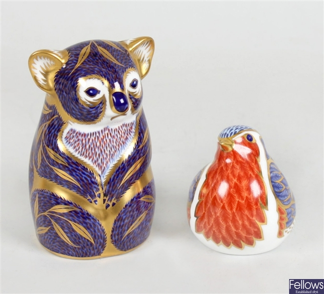 A Royal Crown Derby ornament modelled as a Koala and a similar ornament modelled as a bird