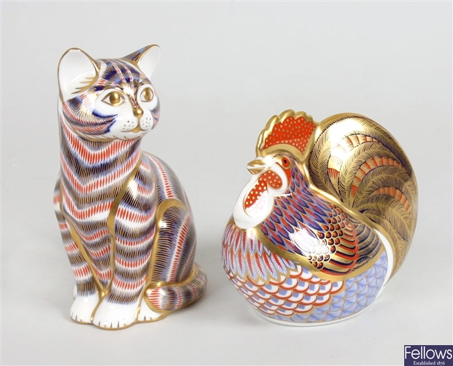 A Royal Crown Derby bone china ornament modelled as a cat and a similar cockerel