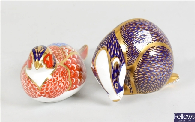 A Royal Crown Derby bone china ornament modelled as a badger and a similar game bird