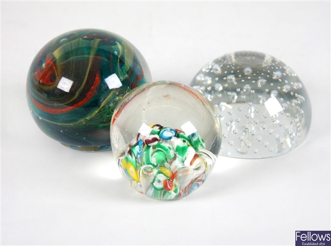 An Isle of Wight glass paperweight with internal coloured glass and other paperweights