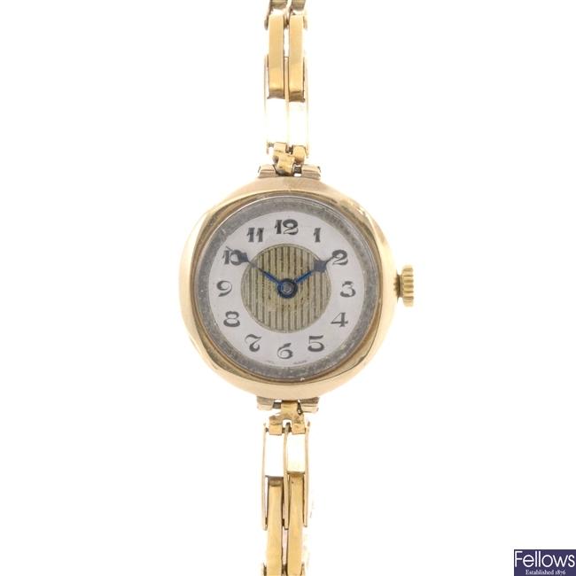 A 9ct gold manual wind lady's Buren bracelet watch.