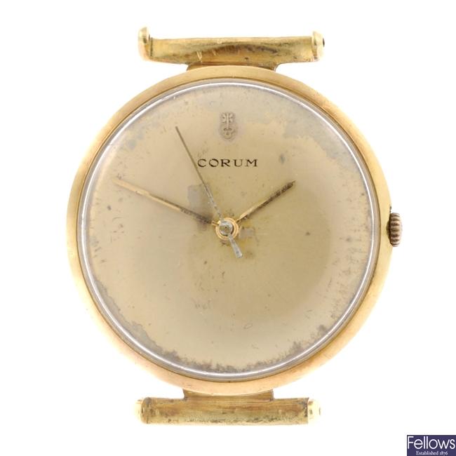 CORUM - an 18K gold automatic gentleman's wrist