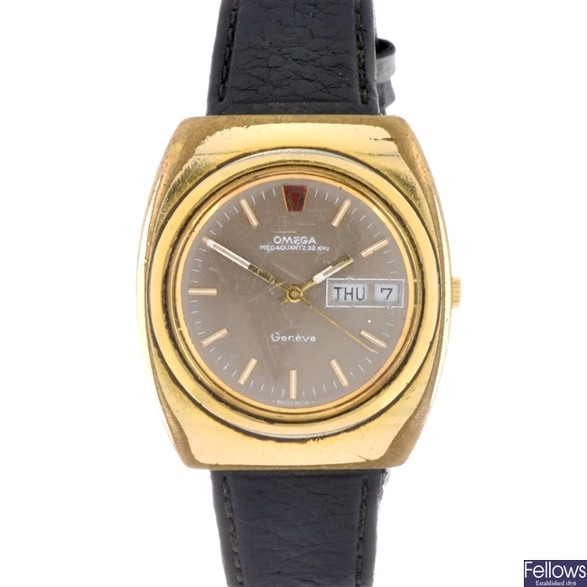 A gold plated quartz gentleman's Omega Megaquartz 32 KHz Geneve wrist watch.