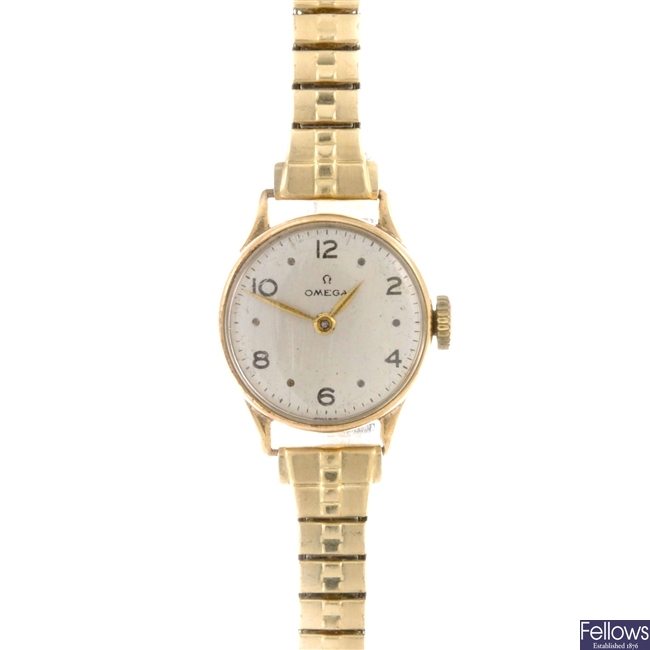 A group of four 9ct gold ladies Omega wrist watches.