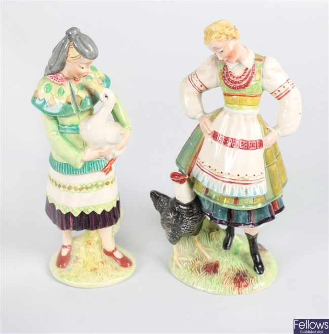 A Beswick figurine modelled as a lady holding a goose and a figurine of a lady with a black rooster