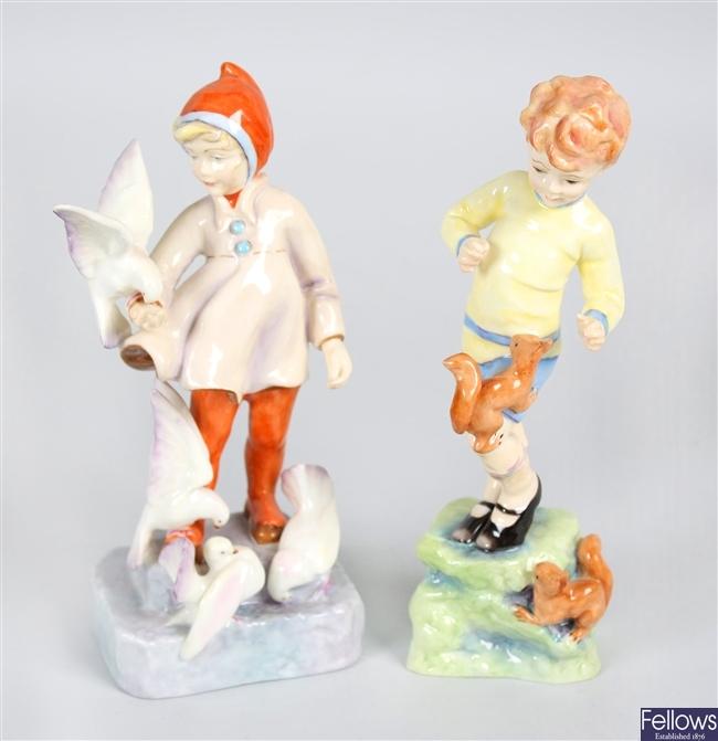 A Royal Worcester bone china figurine 'October' and a similar 'November'
