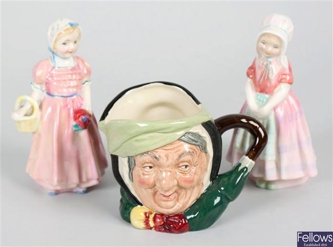 Two small Royal Doulton bone china figurines and a Royal Doulton character mug
