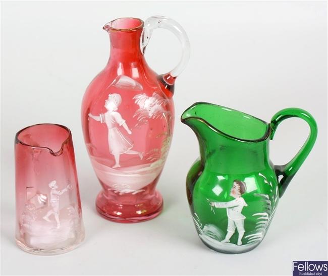 Six coloured glass jugs
