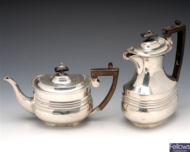 Edwardian silver teapot and hot water pot.