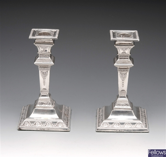 Pair of Victorian silver candlesticks.
