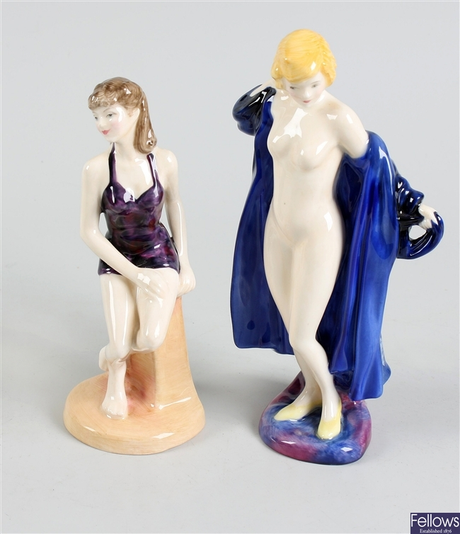 Two Royal Doulton bone china figurine 'The Bather' and 'Taking The Waters'