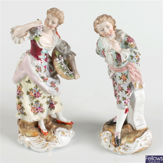 A pair of Volkstedt porcelain figures