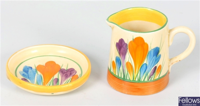 A Clarice Cliff Newport pottery cream jug and similar pin dish
