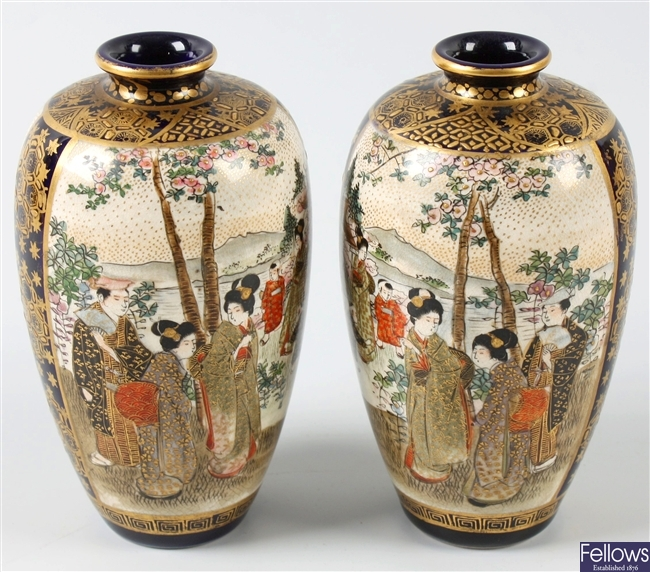 A pair of early 20th century oriental pottery vases