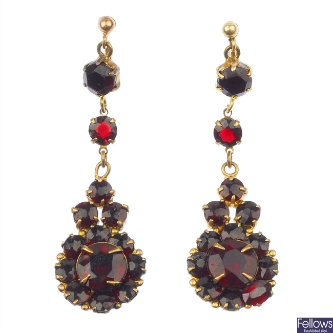 A pair of red-gem ear pendants.