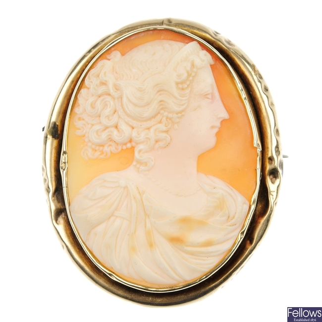Two cameo brooches and a cameo pendant.