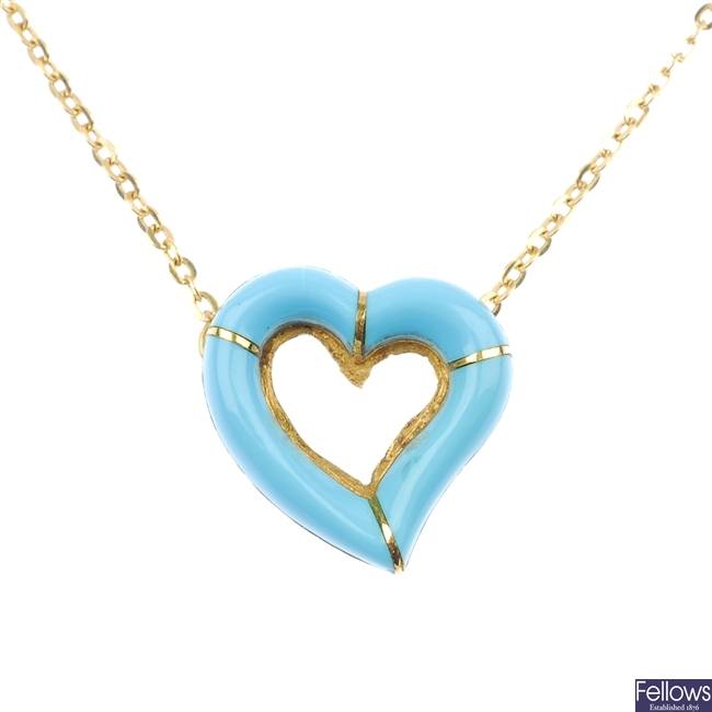 A reconstituted turquoise heart pendant.