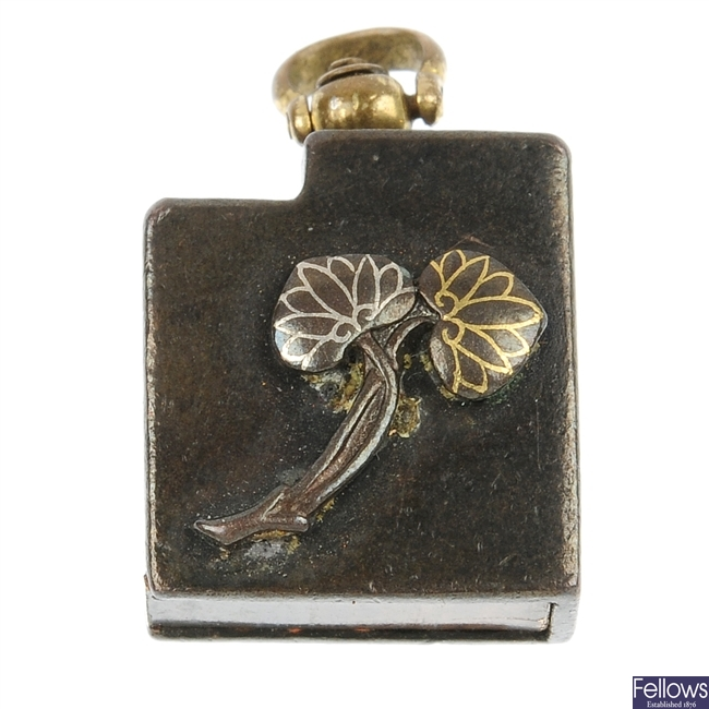 A mixed-metal pendant.