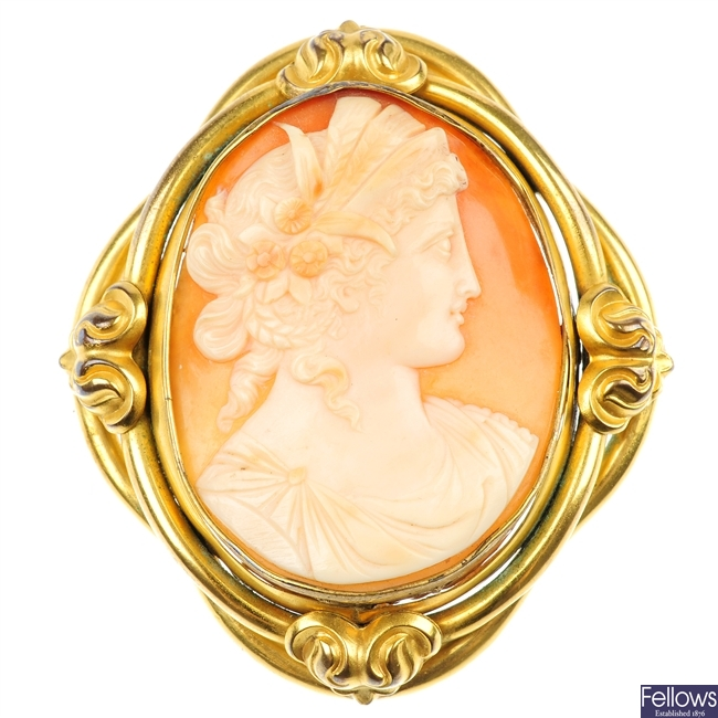 A cameo brooch and a painted porcelain brooch.