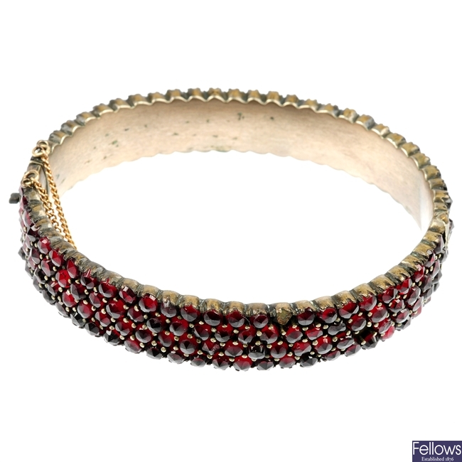 A late 19th century Bohemian garnet hinged bangle.