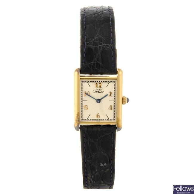 A gold plated silver quartz Must de Cartier wrist watch.